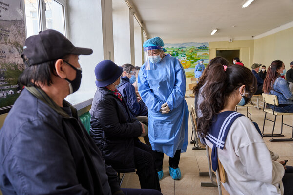 A nurse checking on patients who just received a vaccine in Ulaanbaatar, Mongolia, last month.