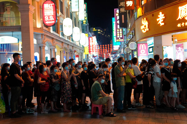 Residents line up for coronavirus testing in the Liwan District in Guangzhou in southern China's Guangdong province on Wednesday.