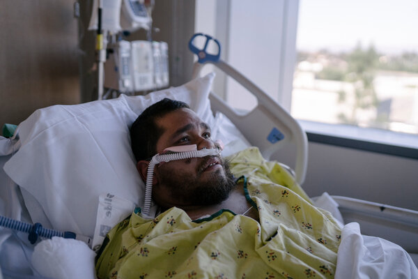 Gilbert Torres, 30, a few hours after being extubated in January, in the intensive care unit of a Los Angeles hospital.