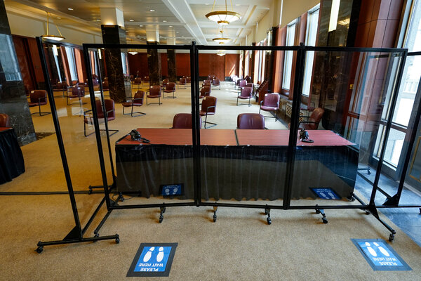 Plexiglass panels separated an area for courthouse employees from the seating area for potential jurors at a federal courthouse in Manhattan, in March.