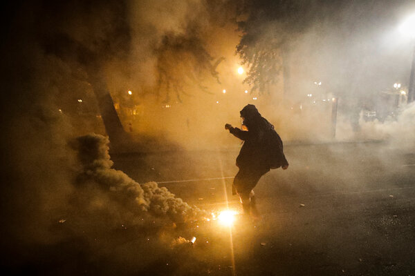 A demonstrator kicked a tear gas canister back at federal officers during a Black Lives Matter protest in Portland, Ore., last summer.