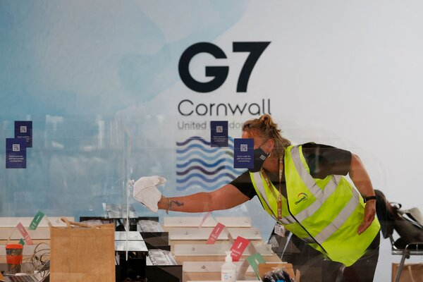 A worker cleaning partitions at the Group of 7 media center in Falmouth, Cornwall, on Thursday.