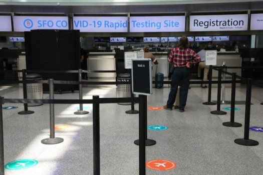 A free coronavirus rapid testing site for travelers was almost empty at San Francisco International Airport last month.