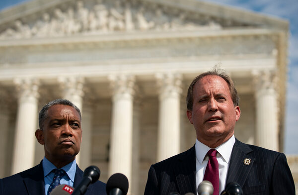 Ken Paxton, the attorney general of Texas, right, is under investigation for professional misconduct over his legal challenge to President Biden's 2020 victory.
