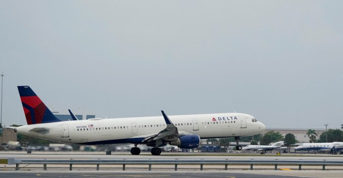 Off-Duty Flight Attendant Is Detained After an In-Flight Struggle, Delta Says