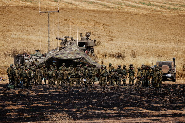 Israeli soldiers near the border between Israel and Gaza on Friday.