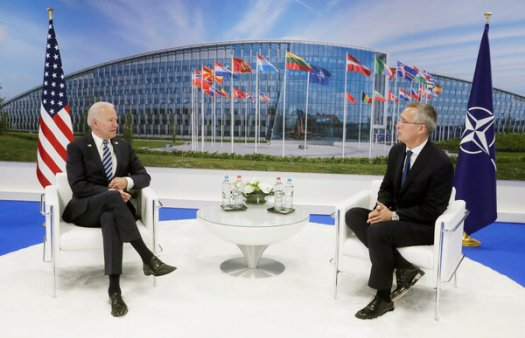 President Biden met with NATO's secretary general, Jens Stoltenberg, at the summit in Brussels on Monday.