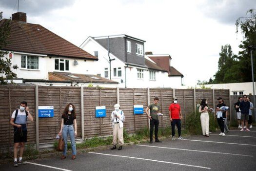 People waiting in line to receive coronavirus vaccines at a health center in London last week.
