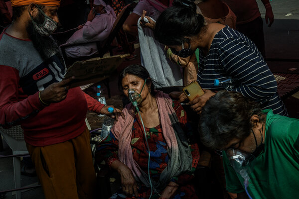 People with breathing problems receiving free oxygen support in Delhi last month.