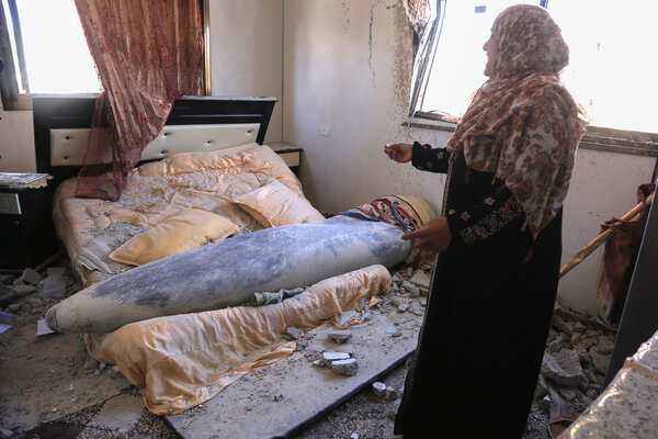 Amna Hadayed standing next to an unexploded Israeli bomb that fell inside her daughter's home on Thursday in Khan Younis, southern Gaza.
