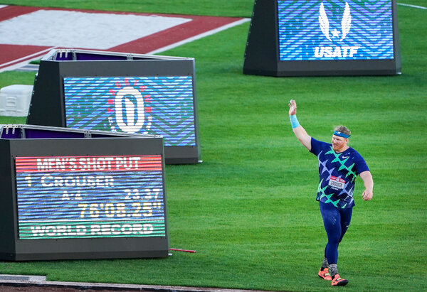 Ryan Crouser with his world record throw displayed on the screen.