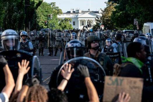 Police officers advancing on protesters outside the White House last June.