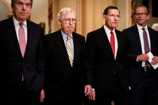 Senators Roy Blunt of Missouri, Mitch McConnell of Kentucky, John Barrasso of Wyoming and John Thune of South Dakota, all Republicans, walk to a news conference on Capitol Hill in Washington on Tuesday.