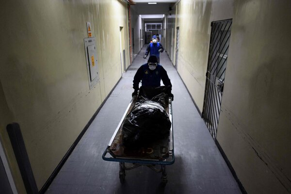 Medical personnel remove the body of a Covid-19 victim from the coronavirus ward at the Honorio Delgado Hospital in Arequipa, Peru, last week, following an outbreak of cases of the Delta strain in the city.
