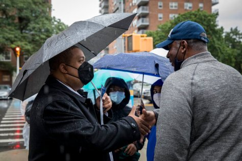 Alvin Bragg, left, campaigning in Harlem on Tuesday.