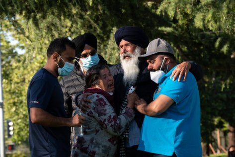 Sarabjit Singh, second from right, mourns for his son Taptejdeep Singh, a victim in the shooting on Wednesday.