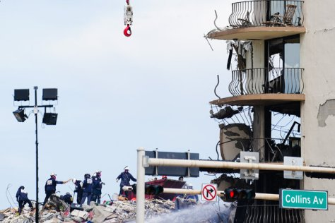 Rescue workers searching through the rubble of Champlain South, the partially collapsed building in Surfside, near Miami Beach, Fla., on Saturday.