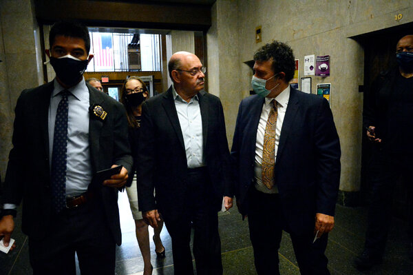 Allen Weisselberg, center, surrendered Thursday morning at the Lower Manhattan building that houses the criminal courts and the district attorney's office.