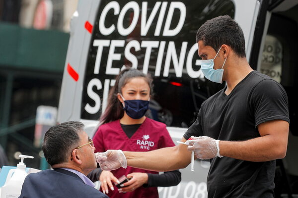 Testing for the virus at a mobile van last month. Coronavirus testing in the city has dropped about 50 percent since April.