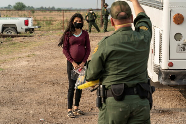 A woman seeking asylum waited to board a Border Patrol bus after crossing the Rio Grande in La Joya, Texas, in April.