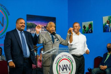 The Rev. Al Sharpton, center, hosted Alvin Bragg, left, and Eric Adams, right, in Harlem on Saturday.