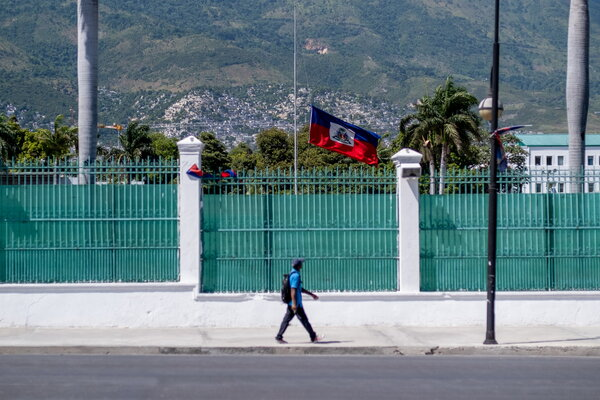 The Haitian national flag was flown at half-mast at the former site of the Haitian presidential palace after the assassination of President Jovenel Moïse, in Port-au-Prince, on Saturday.
