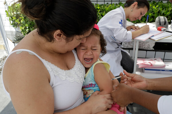 A child receiving a yellow fever vaccine in Sao Paulo, Brazil, in 2018. Routine childhood vaccinations have dropped offin Latin America since the pandemic began.