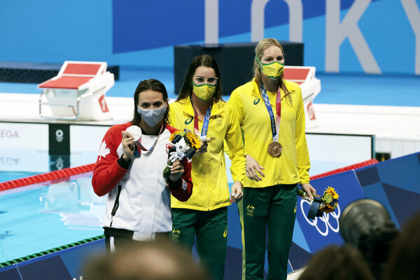Kaylee McKeown, center, won gold in the 200-meter backstroke, while Kylie Masse, left, of Canada got silver and Emily Seebohm of Australia took bronze.