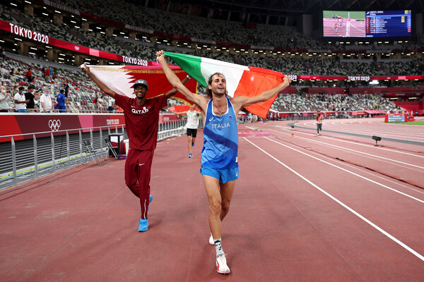 Mutaz Essa Barshim, left, and Gianmarco Tamberi celebrate their win after agreeing to a tie in the men's high jump.