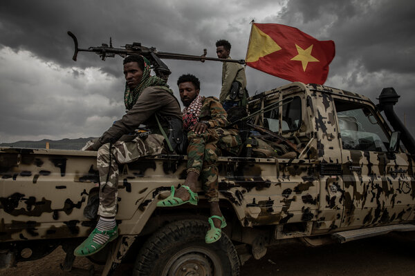 Fighters from the rebel Tigray Defense Forces rested on a pickup truck outside Mekelle.