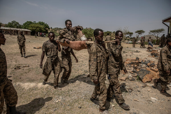 An injured Ethiopian soldier was carried by his comrades at a prison camp.
