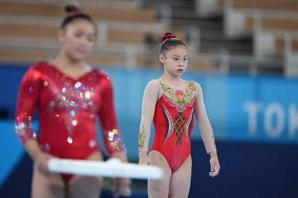 Guan Chenchen of China finished first in qualifying on the balance beam, in part because her routine was more difficult than the ones performed by others.