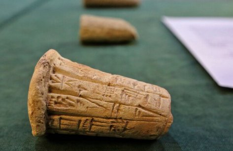 Mesopotamian clay pieces bearing cuneiform inscriptions on display during a ceremony on Tuesday in Baghdad to mark the handover of the looted antiquities.