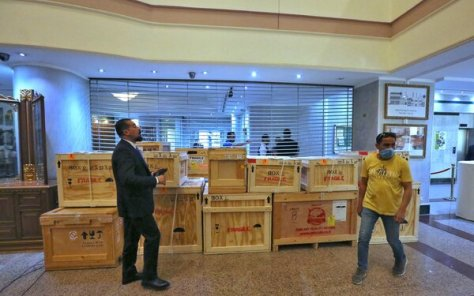 Employees at the Iraqi Ministry of Foreign Affairs in Baghdad on Tuesday working around crates of looted antiquities returned from the United States.