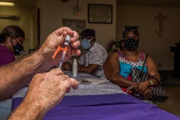 A healthcare worker prepares a coronavirus vaccine in Moultrie, Ga. last week.