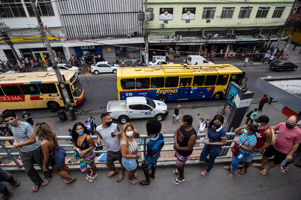 People lined up to receive coronavirus vaccines at a train station in Duque de Caxias, Brazil, on Wednesday.