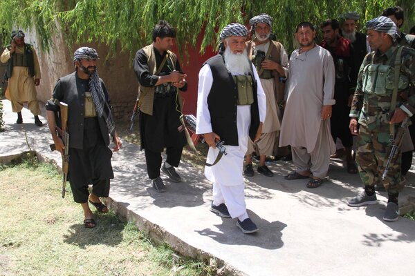 Mohammad Ismail Khan, center, last week in Herat. He rose to prominence in the mujahedeen resistance to the Soviets, and then fought against the Taliban in the 1990s.