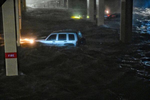 Storm surge swamped vehicles in Biloxi, Miss., when Hurricane Zeta made landfall in 2020.