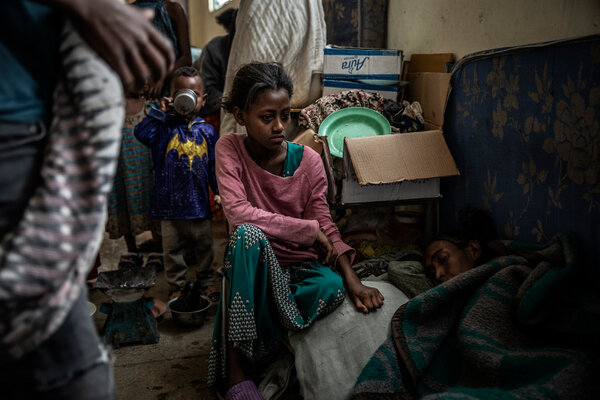 Azemeru Abraha, 13, and her ailing mother, Ametkiros Abraha, were among about two million people displaced by Ethiopia's war in the past nine months. They were staying in June at a school housing several thousand people in Mekelle.