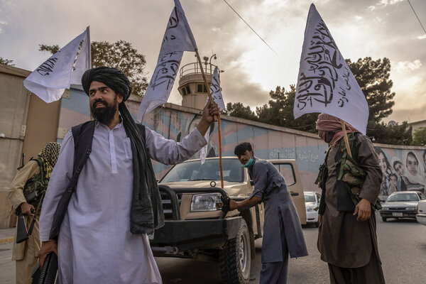 Taliban members outside the closed U.S. Embassy in Kabul on Sunday.