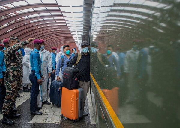 Nepalis arriving at the international airport in Kathmandu last week after being evacuated from Afghanistan.