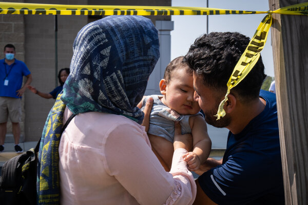 Sayed, right, was reunited with his wife, Kebria, and 6-month-old son, Mustafa, after they were released from the Dulles Expo Center in Chantilly, Va., following their evacuation from Afghanistan.