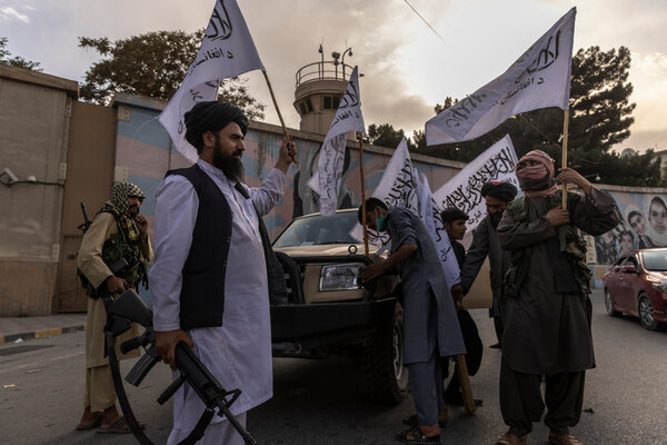 Buying Taliban flags outside the U.S. Embassy in Kabul, Afghanistan, on Sunday.