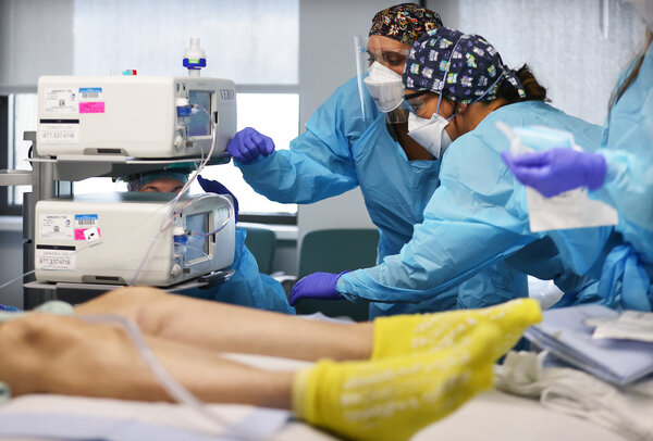 Medical workers as their team prepared to intubate a Covid-19 patient in the intensive care unit at Lake Charles Memorial Hospital in Louisiana this month.
