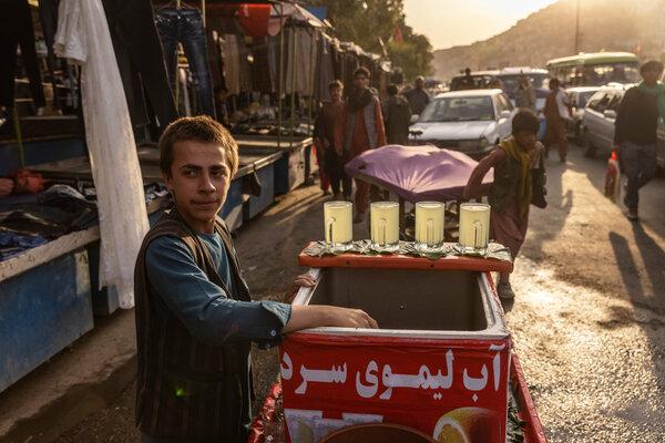 A lemonade seller in a market in Kabul last week.