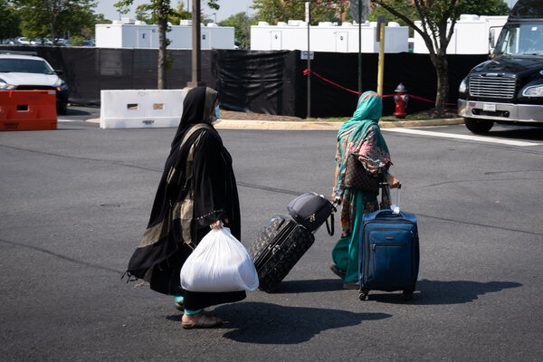 Afghanistan evacuees departing from a processing center at the Dulles Expo Center in Virginia on Thursday.