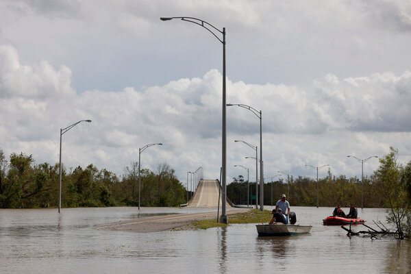 Floodwater blocked access on Monday to a bridge leading to Jean Lafitte, La., over the Gulf Intracoastal Waterway.