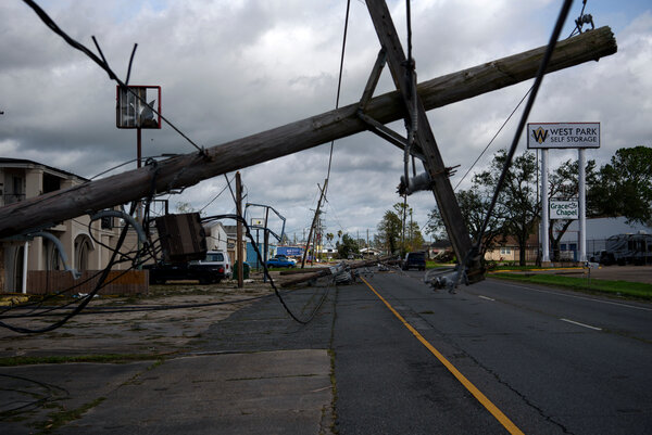 Downed lines in Houma, in southeast Louisiana, on Monday. The financial costs of storms are piling up for Entergy.