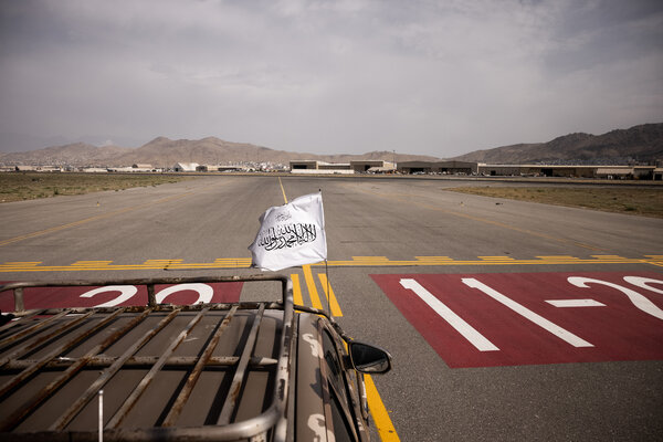 A vehicle flying a Taliban flag near the runway at the Kabul airport on Tuesday.