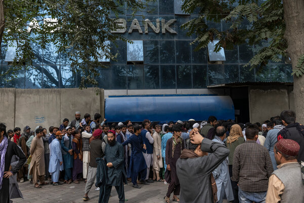 Outside a bank branch in Kabul, Afghanistan, on Monday. Long lines seeking to withdraw money have become a daily norm.